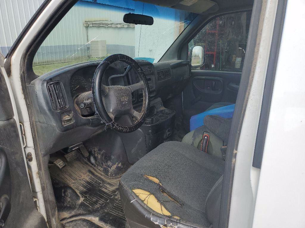 2002 Chevrolet Express Cargo 1500 | Chamberlain, SD, Summit White (White), Rear Wheel