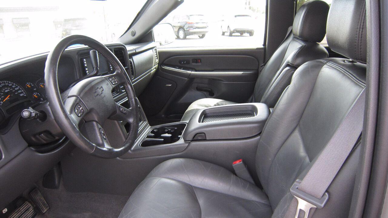 2004 Chevrolet Avalanche 1500 | Mitchell, SD, Sunburst Orange Metallic II (Red & Orange), Rear Wheel