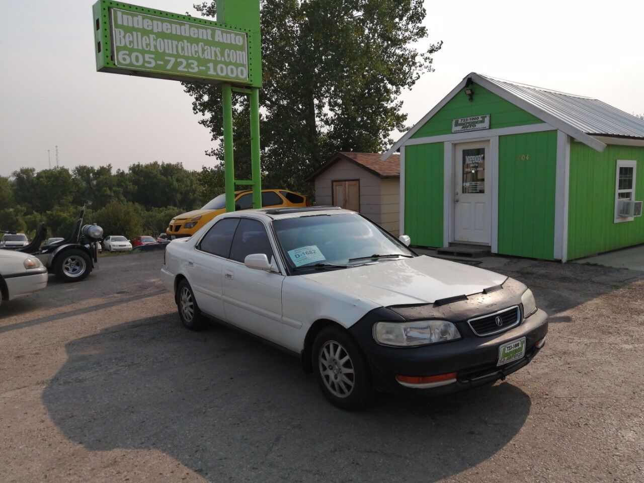 1998 Acura TL 2.5 | Belle Fourche, SD, Cayman White Pearl Metallic (White), Front Wheel